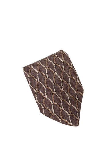 chanel patterned brown silk neck tie. features beige and tan linked arch pattern throughout in a wide cut. black logo print lining, gold-toned chain detail at back under label.