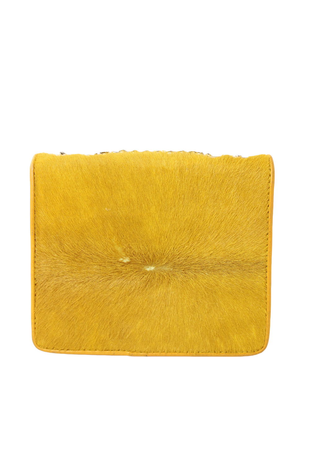 unlabeled yellow calf hair purse. features chain handle and flap with magnetic snap closure.
