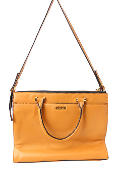 milly tan leather handbag. features zipper closure, 6 pockets total & a shoulder strap.