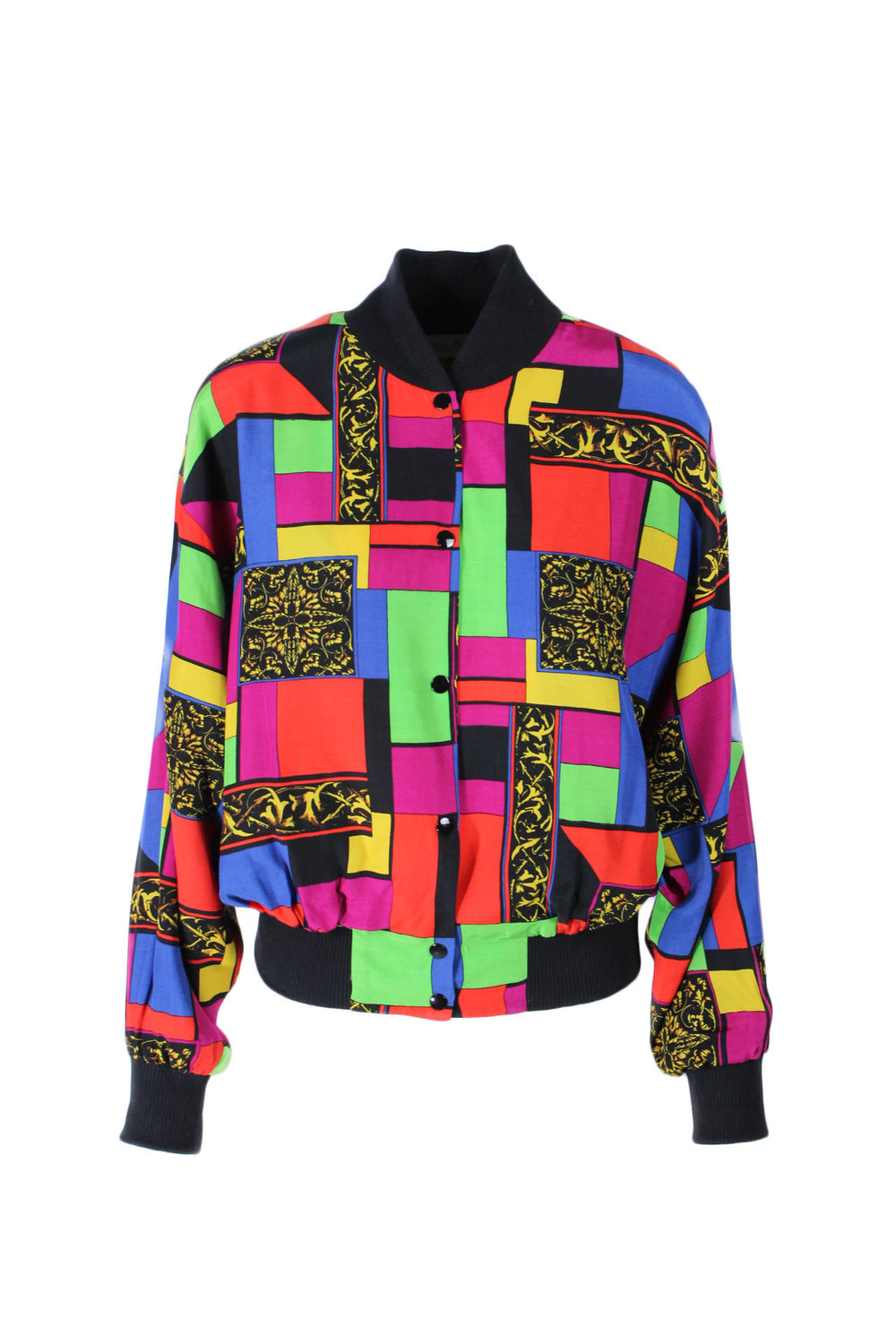 nora zandré color block patterned jacket. features light shoulder pads & snap button closure.