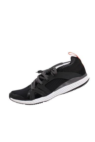 didas x stella mccartney black running sneakers. features gray laces & red back handle.
