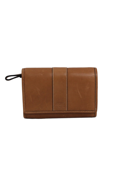 coach tan leather wallet bag. features snap button closure 4 pockets & card slots.
