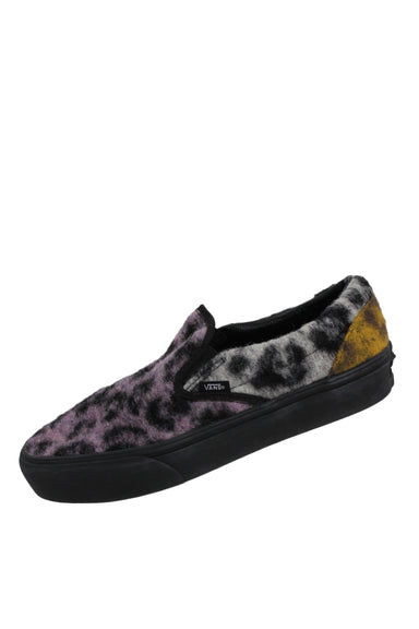 vans multi-colored fuzzy animal print slip ons. features black midsole & outsole.