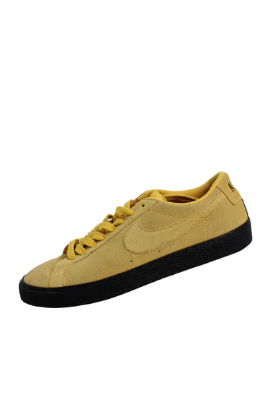 nike sb yellow suede blazer low top sneakers. features black midsole.