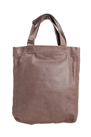m0851. taupe leather tote bag. features puffer lining, four internal pockets, & a snap button closure flap.