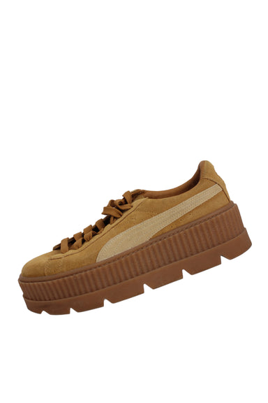 "fenty x puma tan cleated platform sneakers. features 2"" platform."