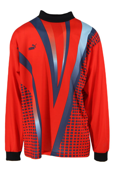 puma red and blue long sleeve graphic shirt. features chest logo with geometric graphics throughout in a relaxed cut. black ribbing at mock neck and cuffs, drop shoulder.