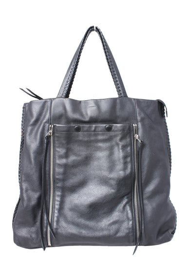 all saints black leather tote bag. featuring stitched leather side and handle details. with adjustable front pocket with zipper details, 3 large inside sections (one with zip closure), and silver purse feet.