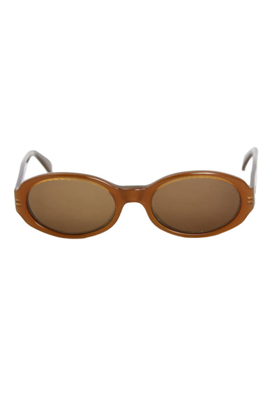 jag amber and olive colored oval sunglasses. featuring amber colored lenses and slightly translucent frame.