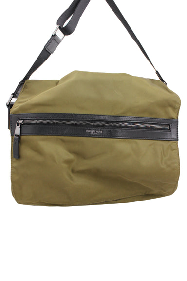 michael kors olive nylon messenger bag. features adjustable black strap and black zipper panel at flap. top zip closure, inner zippered wall pocket and 2 pouch pockets at inner lining. zippered pocket at back, flap overlay with hidden magnetic fasteners.