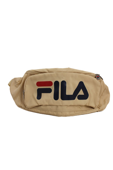 fila beige textile crossbody bag. features red and navy front logo and square zipper pulls with tonal adjustable strap and plastic buckle closure. zippered main compartment, back wall pocket, and front pouch pocket. unlined.
