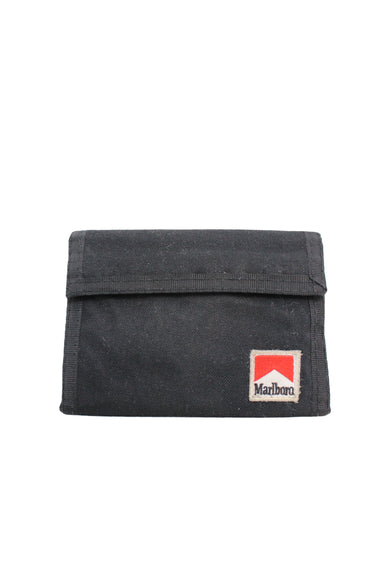 vintage marlboro black tri-fold velcro wallet. features 'marlboro' logo patch at front, with currency and card slots within.