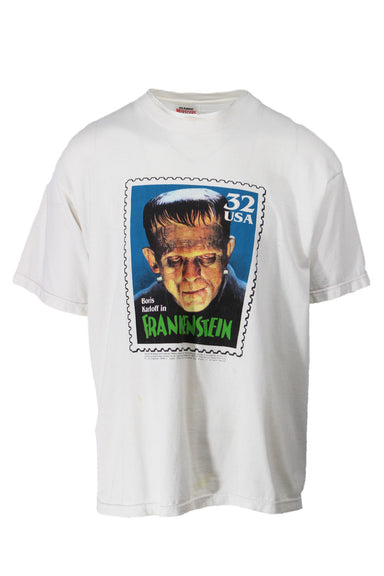 "vintage 1997 classic monsters stamps tee. large frankenstein stamp graphic at front. sold in ""as is"" condition for staining (see photos)."