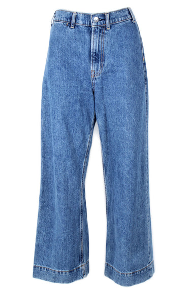 everlane medium wash blue jeans. features wide cropped leg, brown contrast stitching throughout, with silver tone hardware and zip closure.