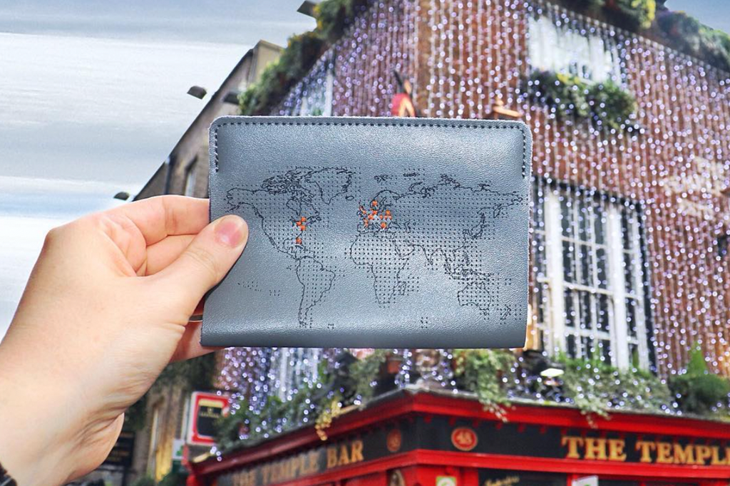 Stitch where you've been map passport cover in grey leather with orange thread