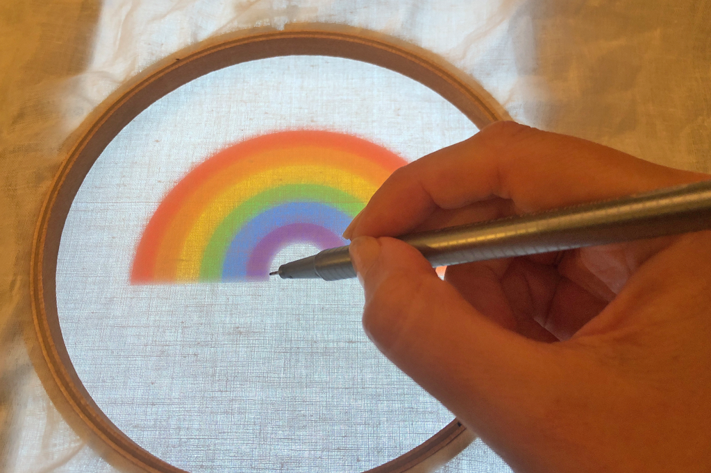 tracing rainbow in hoop for embroidery