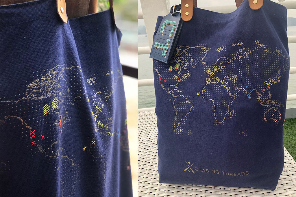 Stitch navy tote bag with icons and crosses sewn