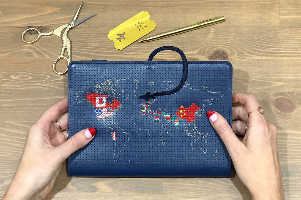 Navy stitch travel notebook sewn with flags of the world