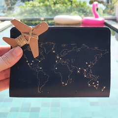 navy stitch passport cover with gold threads at pool Thailand