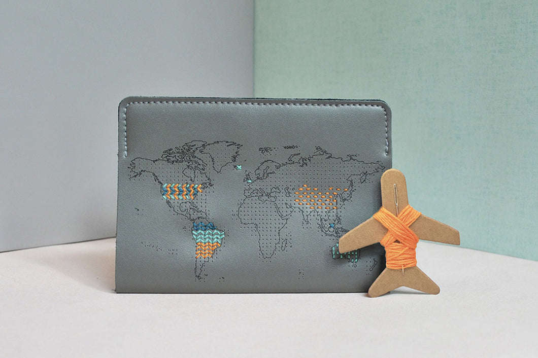 Grey stitch passport cover with patterns sewn