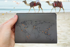 Grey stitch passport on travels