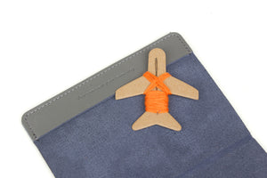Grey cover and orange thread