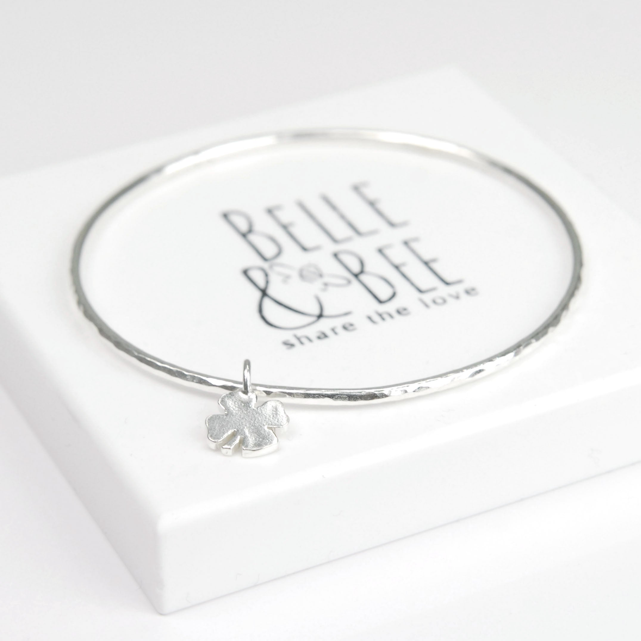 Belle & Bee 2mm Sterling Silver Hammered Bangle with Mini Chunky Clover Charm