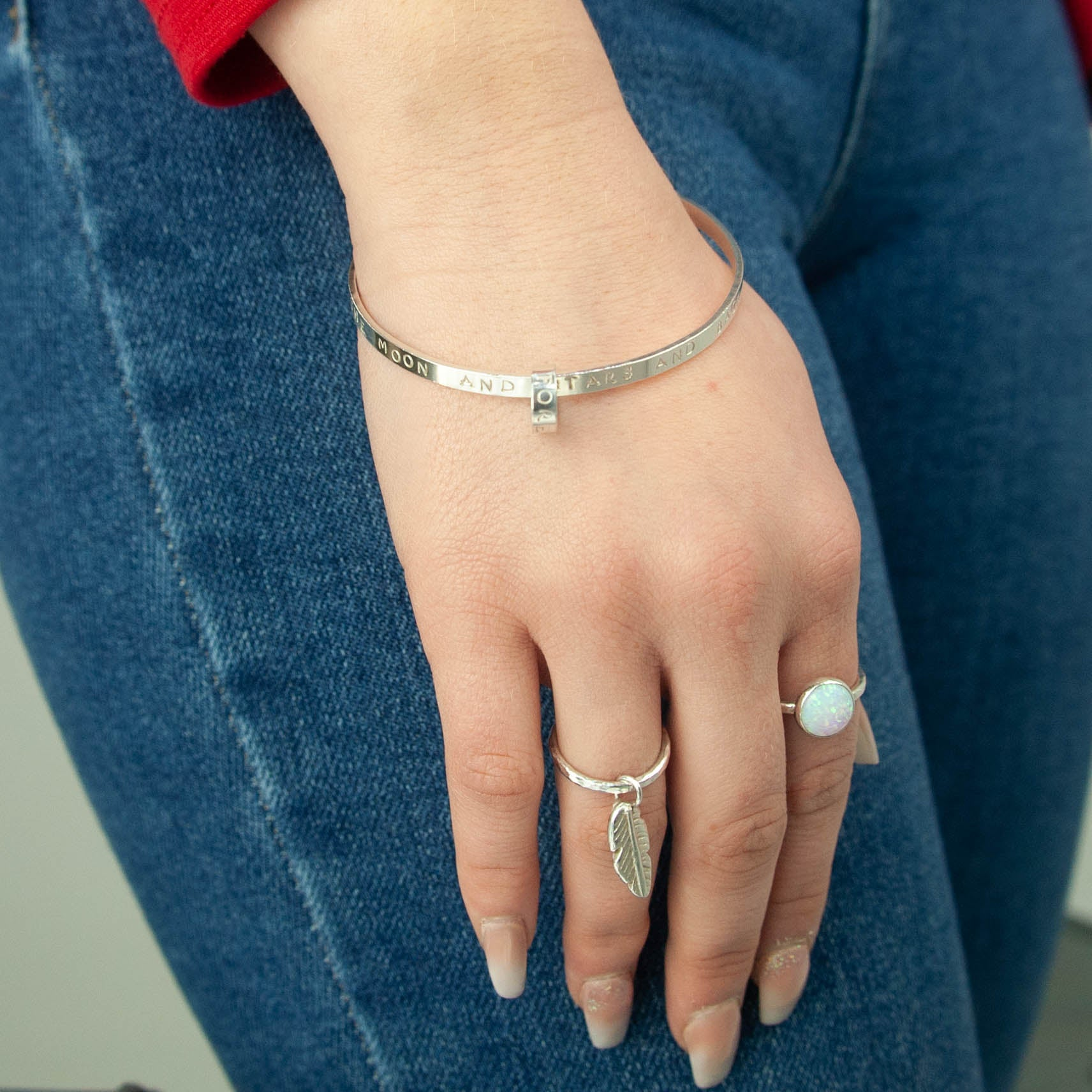 Belle & Bee Sterling Silver 2mm Hammered Stacking Ring with Mini Chunky Feather Charm