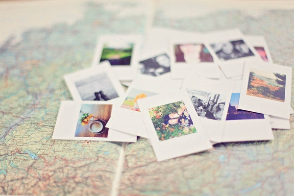 Eve and Elle polaroid pictures on travel map