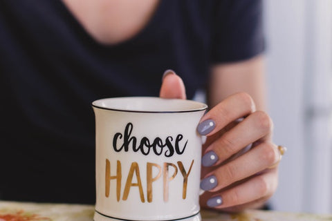 girl holding mug with text choose happy eve and elle