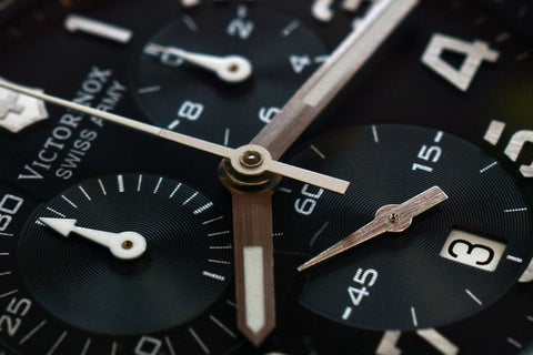 Gears on a time piece watch in black and wood