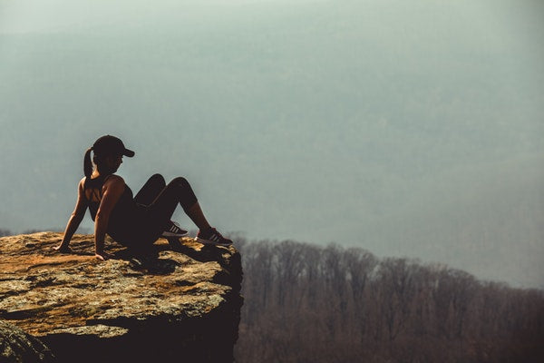 woman sitting on mountain eve and elle