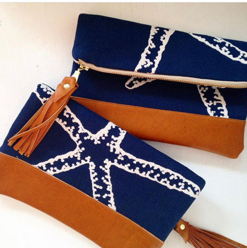 Navy starfish fold over clutch bag