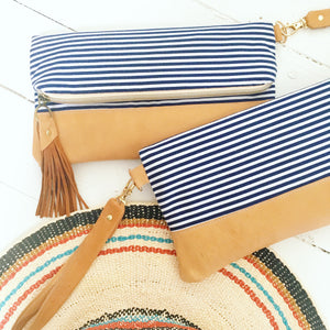 Navy striped fold over clutch bag