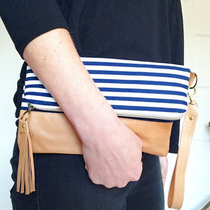 Navy and white striped fold over clutch bag
