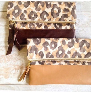 Snow leopard clutch bags