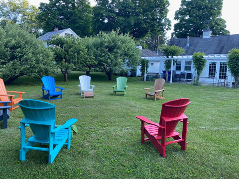 Outdoor space behind yarn shop studio with Adirondack chairs set up for socially distanced stitch circles and help sessions
