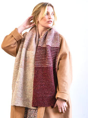 Blond woman wearing Waitsfield: An oversized scarf that blends color to color with a simple mosaic slip stitch motif made popular by our Fern Lake blanket; designed by Amy Christoffers in Berroco Mochi (Vanilla, Red Bean, Garnet)