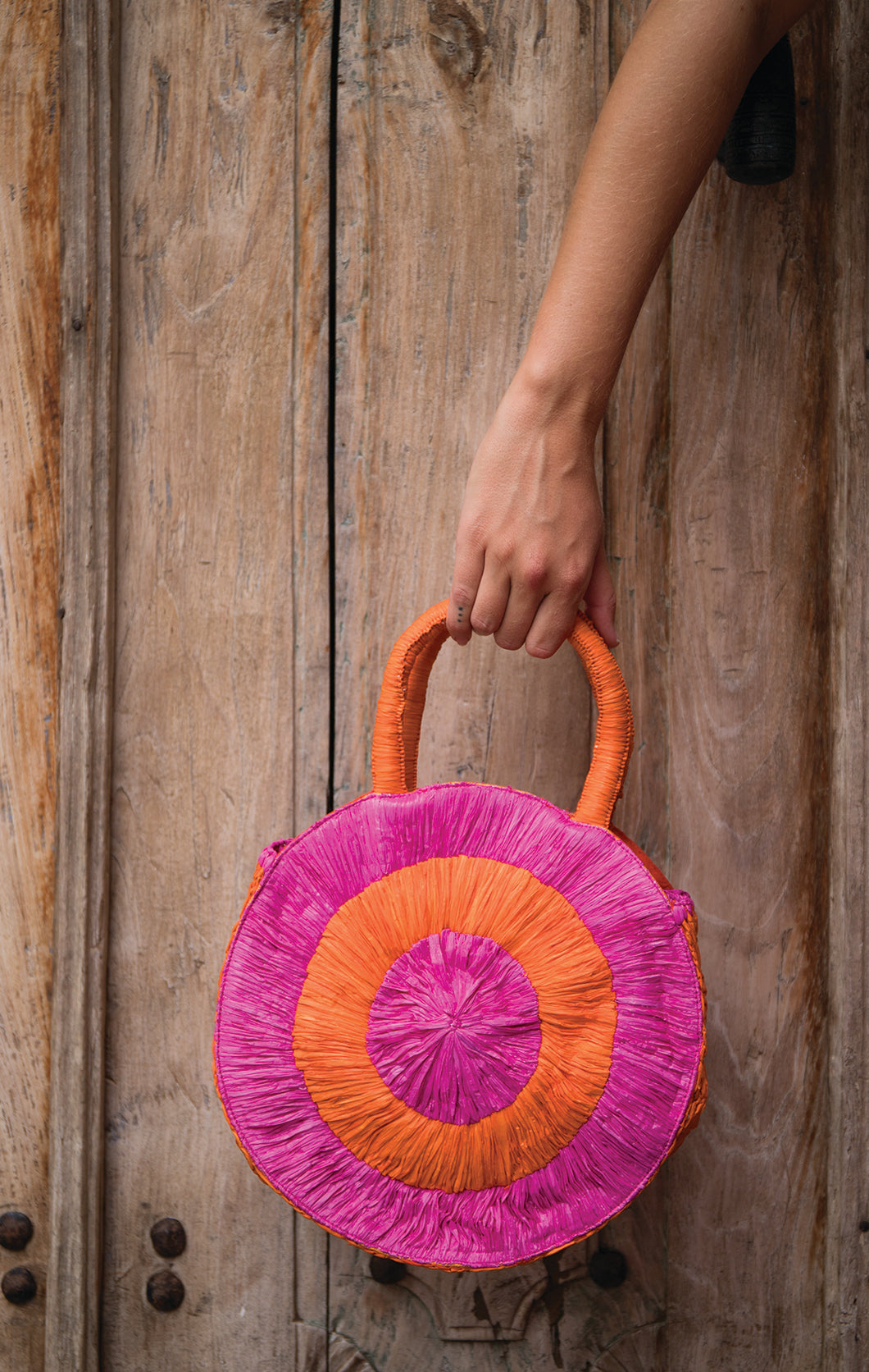RAFFIA ROUND BAG ORANGE/PINK