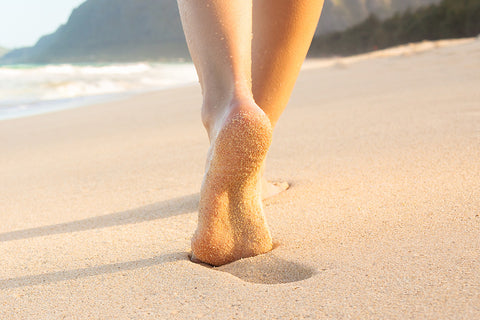 Why walking barefoot on the beach is bad for your feet
