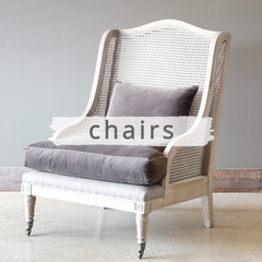 Grey velvet upholstered arm chair with caning