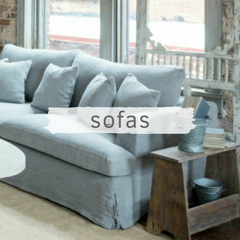 Light blue slipcoveted sofa