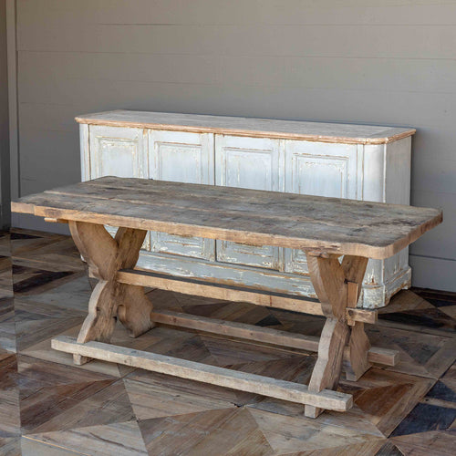 Homestead Table With Rough Hewn Wood And A Distressed Finish.