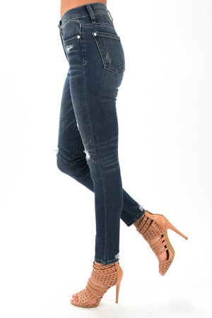 #502 The Distressed Patch Jeans