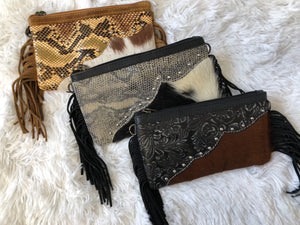 Animal fur and leather fringe clutch