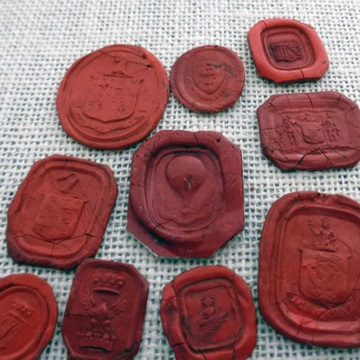 Collection of 10 antique Georgian and Victorian wax seal impressions - Early Hot air balloon and Heraldic Crests
