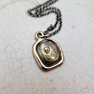 Skull and Crossbones - I do not fear your heart necklace in Bronze