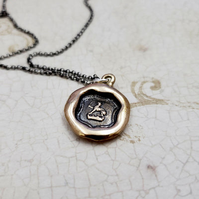 Dog and Sword Protection Necklace in bronze