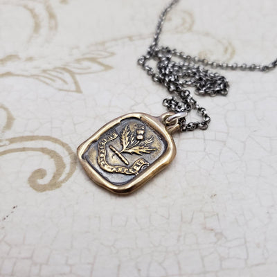 Sweeter after difficulties Thistle necklace in Bronze