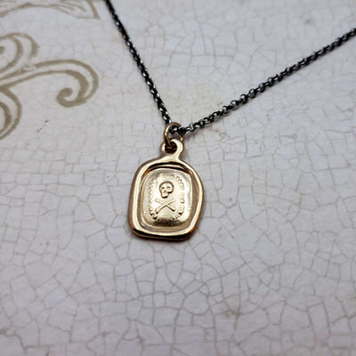 Skull & Crossbones 'I do not fear your heart' necklace in Gold Vermeil